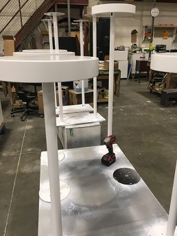 Painted bases to hold vitrines for jewelry displays